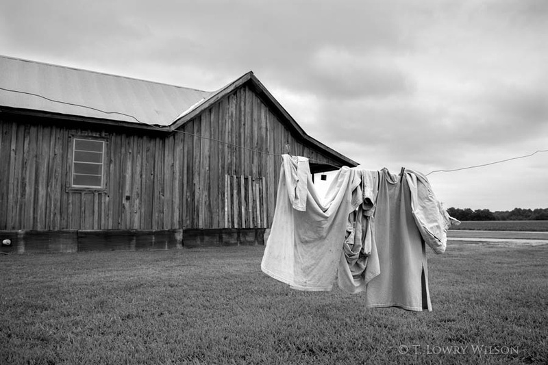 wash day clothes on line outside old shack